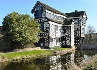 Spring reflection of Little Moreton Hall
