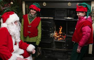 Father Christmas in Aunt Mary's cottage at The Farm